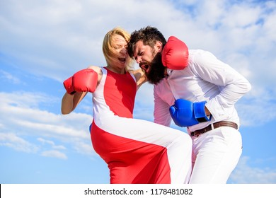 Pursue course of self defence. Attack is best defence. Defend your opinion in confrontation. Man and woman fight boxing gloves sky background. Female attack. Take course to be confident in safety.