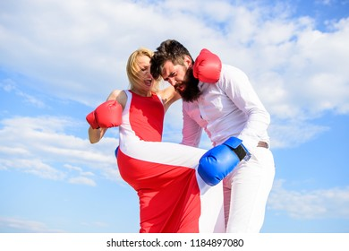 Pursue course of self defence. Attack is best defence. Defend your opinion in confrontation. Man and woman fight boxing gloves sky background. Take course to be confident in safety. Female attack.