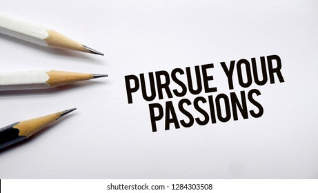 Pursue your passions text memo written on a white background with pencils