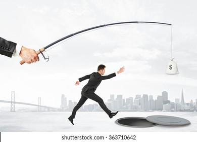 The pursuit of money with businesman jumping into the abyss and rod with a bag of money