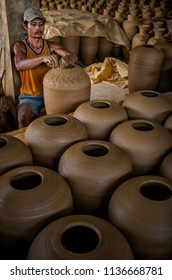 Purwakarta, West Java, Indonesia (08/15/2015) : The local artisan making pottery in centre of production in Plered, Purwakarta, Indonesia. Plered become centre of small scale industry of pottery.