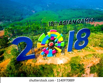 Purwakarta, West Java / Indonesia - July 22, 2018: Aerial View of Logo 18th Asian Games 2018 Giant Name Sign Located on the Top of Hill, Alongside Jakarta - Bandung Cipularang Toll Road