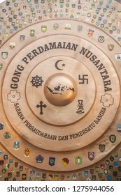 "PURWOREJO, JAWA TENGAH, INDONESIA, January 5, 2019: Residents visit a tourist destination ""Archipelago Peace Gong""/Gong Perdamaian Nusantara located in Purworejo Square, Central Java, Indonesia."