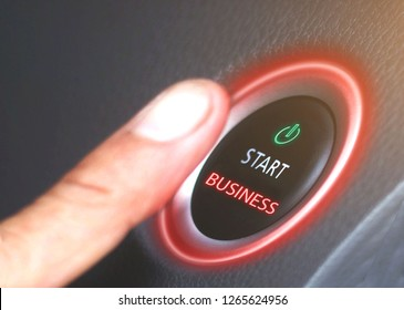 Push the business start button on a black background, red light, symbol of new business, business concept.