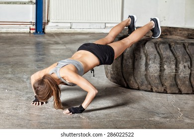 Push up exercise on a tire fitness training