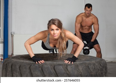 Push up on a tire crossfit training