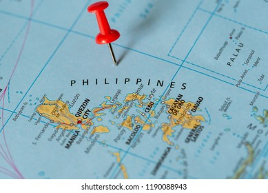 Push pin on the territory of Philipines on the world map