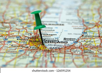 push pin pointing at Chicago, USA