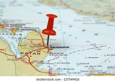 push pin pointing at Doha, Qatar