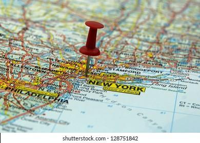 push pin pointing at New York, USA