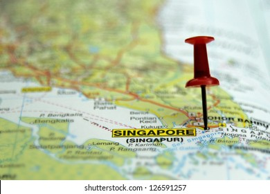 push pin pointing at Singapore