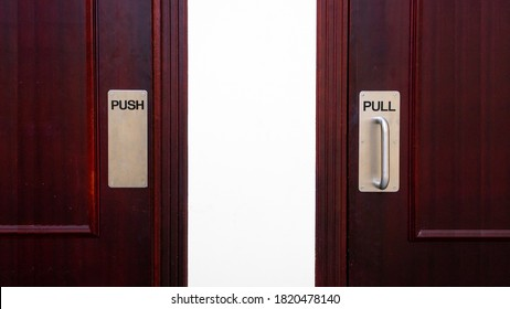 Push and pull sign on a door at a apartment.