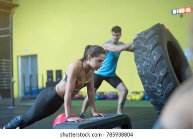 Push ups and wheel training in crossfit room