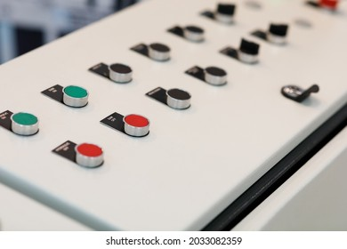 Pushbuttons on the control console of the manufacturing machine. Selective focus on the SAW OFF button.