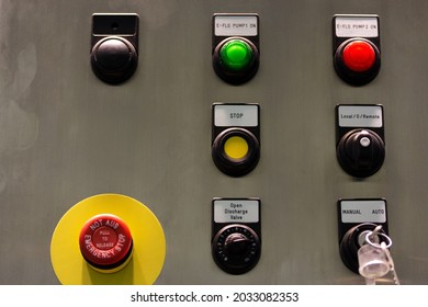 Pushbuttons and switches on the control panel of industrial equipment. Selective focus.