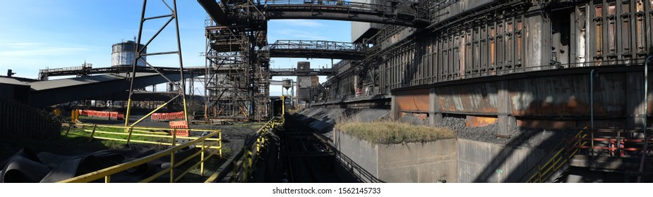 Pushing and quenching hot coke on a large coke oven complex.