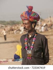PUSHKAR, INDIA, 18 NOVEMBER 2015 : Portrait of Rajasthani man wearing traditional dress and turban visit to Pushkar Camel fair. Pilgrims and camel traders came to the holy town for the annual fair.