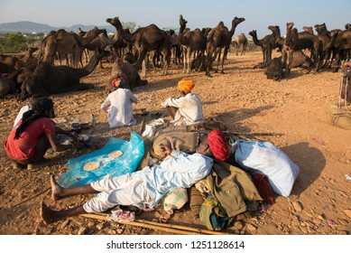 Pushkar / India 18 November 2018 Camel traders relaxing during the Pushkar Camel Fair or Pushkar Mela at Pushkar Rajasthan India