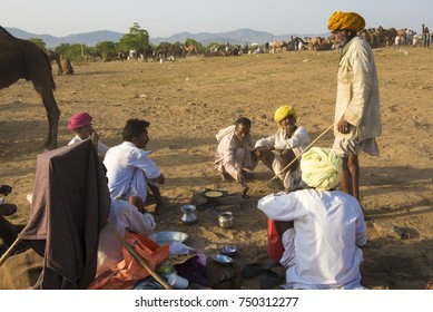 Pushkar / India 27 October 2017 Group of camel herders relaxing and talking about business in the  Pushkar Camel Fair in Rajasthan India