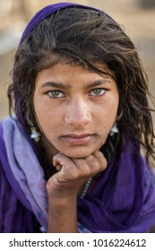 Pushkar, India- April 05 2017: Portrait of a beautiful  Indian gypsy girl in her village close to the city of Pushkar, Rajasthan, India.