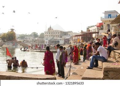 PUSHKAR, INDIA - December, 2017: Indian people visiting Pushkar holy lake, Rajasthan, India