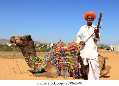 PUSHKAR, INDIA - FEB 5: An unidentified nomad plays ravanahatha in the deserts on February 05, 2015 in Pushkar, India. Ravanahatha is an ancient instrument used by traditional folk singers in India.
