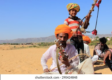 PUSHKAR, INDIA - FEB 5: Unidentified nomads plays ravanahatha in the deserts on February 05, 2015 in Pushkar, India. Ravanahatha is an ancient instrument used by traditional folk singers in India.