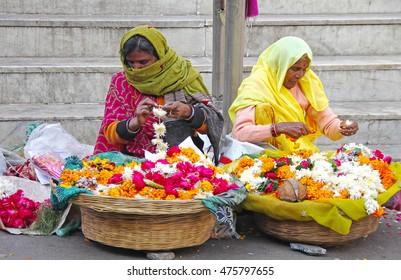 PUSHKAR, INDIA - JAN 5, 2015:  Two woman selling flowers in Indian market