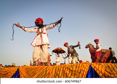 PUSHKAR, INDIA - MAR 7, 2012. Rajasthani folk dancers in colorful ethnic attire perform in Pushkar, India. Pushkar is a town in the Ajmer district in the Indian state of Rajasthan.