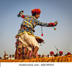 PUSHKAR, INDIA - MAR 7, 2012. Rajasthani folk dancers in colorful ethnic attire perform in Pushkar, India. Pushkar is one of the most ancient cities of India.