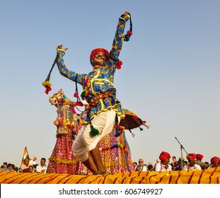 PUSHKAR, INDIA - MAR 7, 2012. Rajasthani folk dancers in colorful ethnic attire perform in Pushkar, India. Pushkar is one of the oldest existing cities of India.