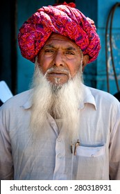 PUSHKAR, INDIA - MARCH 06, 2013: Undefined Indian man with white beard in traditional colourful turban portrait Pushkar, India. March 6, 2013