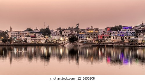 Pushkar, India - Nov 15, 2018: Panoramic sunset view at the buildings around Lake in Pushkar, Rajasthan, India.