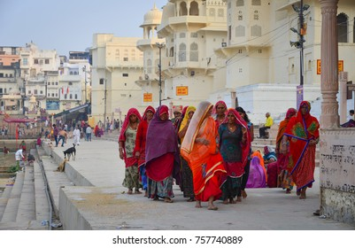 Pushkar, India - Nov 5, 2017. Indian women in sari walking on street in Pushkar, India. Pushkar is a town in the Ajmer district in the state of Rajasthan.