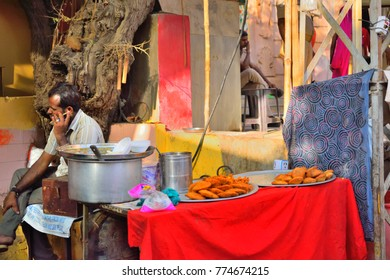 Pushkar, India - November 01, 2017: A man selling kachori, an Indian snack in his shop.