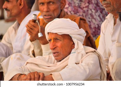 Pushkar, India - November 02, 2017: Portrait of a man sitting in the mela ground watch sporting events.