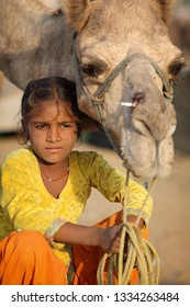 PUSHKAR, INDIA - NOVEMBER 11, 2018: Unidentified Gypsy girl at the Pushkar Camel Fair, Rajasthan. The fair is the largest camel fair in India.