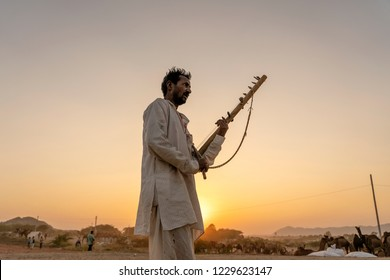 PUSHKAR, INDIA - NOVEMBER 12, 2018 : Unidentified indian musician at the attended the annual Pushkar Camel Mela near holy city Pushkar, Rajasthan, India