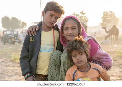 PUSHKAR, INDIA - NOVEMBER 12, 2018 : Indian children in the desert Thar on time Pushkar Camel Mela near holy city Pushkar, Rajasthan, India