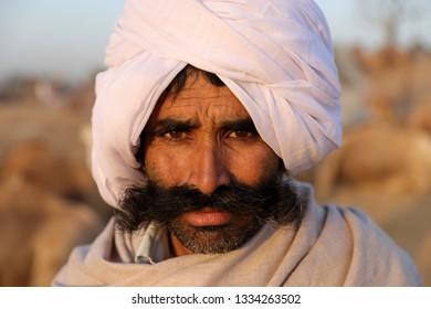 PUSHKAR, INDIA - NOVEMBER 12, 2018: Unidentified Rabari tribal man at the Pushkar Camel Fair, Rajasthan. The fair is the largest camel fair in India.