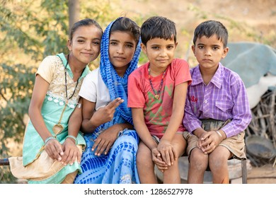 PUSHKAR, INDIA - NOVEMBER 13, 2018 : Indian children in the desert Thar on time Pushkar Camel Mela near holy city Pushkar, Rajasthan, India