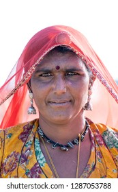 PUSHKAR, INDIA - NOVEMBER 13, 2018 : Indian woman in the desert Thar during Pushkar Camel Mela near holy city Pushkar, Rajasthan, India