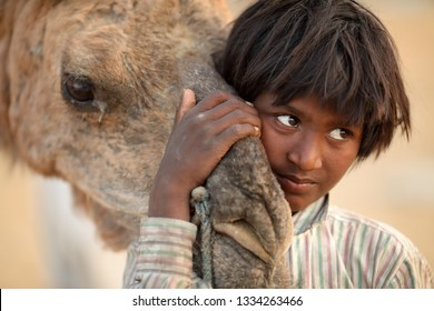 PUSHKAR, INDIA - NOVEMBER 13, 2018: Unidentified Gypsy boy at the Pushkar Camel Fair, Rajasthan. The fair is the largest camel fair in India.