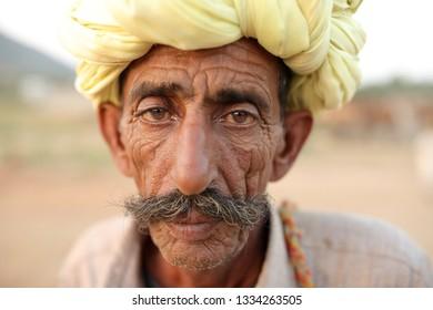 PUSHKAR, INDIA - NOVEMBER 13, 2018: Unidentified old Rabari tribal man at the Pushkar Camel Fair, Rajasthan. The fair is the largest camel fair in India.
