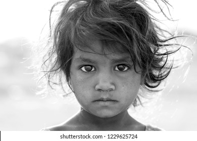 PUSHKAR, INDIA - NOVEMBER 14, 2018 : Indian young girl in the desert Thar on time Pushkar Camel Mela near holy city Pushkar, Rajasthan, India, close up portrait. Black and white, close up