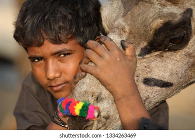 PUSHKAR, INDIA - NOVEMBER 14, 2018: Unidentified Gypsy boy at the Pushkar Camel Fair, Rajasthan. The fair is the largest camel fair in India.