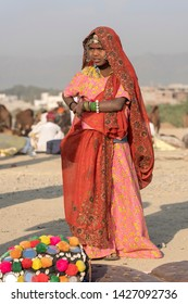 PUSHKAR, INDIA - NOVEMBER 14, 2018 : Indian young girl in the desert Thar on time Pushkar Camel Mela near holy city Pushkar, Rajasthan, India, close up portrait