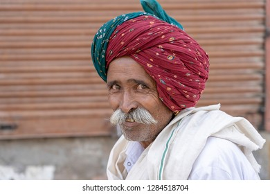 PUSHKAR, INDIA - NOVEMBER 15, 2018 : Indian man during Pushkar Camel Mela near holy city Pushkar, Rajasthan, India. This fair is the largest camel trading fair in the world.