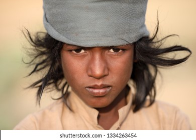 PUSHKAR, INDIA - NOVEMBER 15, 2018: Unidentified Gypsy boy at the Pushkar Camel Fair, Rajasthan. The fair is the largest camel fair in India.