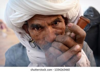 PUSHKAR, INDIA - NOVEMBER 15, 2018: Unidentified Rabari tribal man at the Pushkar Camel Fair, Rajasthan. The fair is the largest camel fair in India.